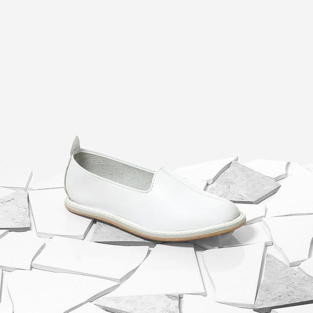 Vayarta Slip-Ons in White