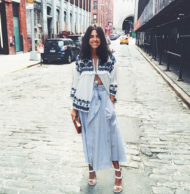 Leandra Medine of Man Repeller wearing Zara top and midi blue skirt with heeled white sandals
