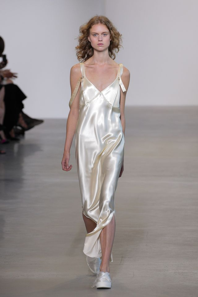 WHAT: Calvin Klein S/S 15 As the face of Calvin Klein, Robbie is regularly spotted in the designer label. Known for its sleek designs, we can imagine a simple silk slip dress would be the order of...