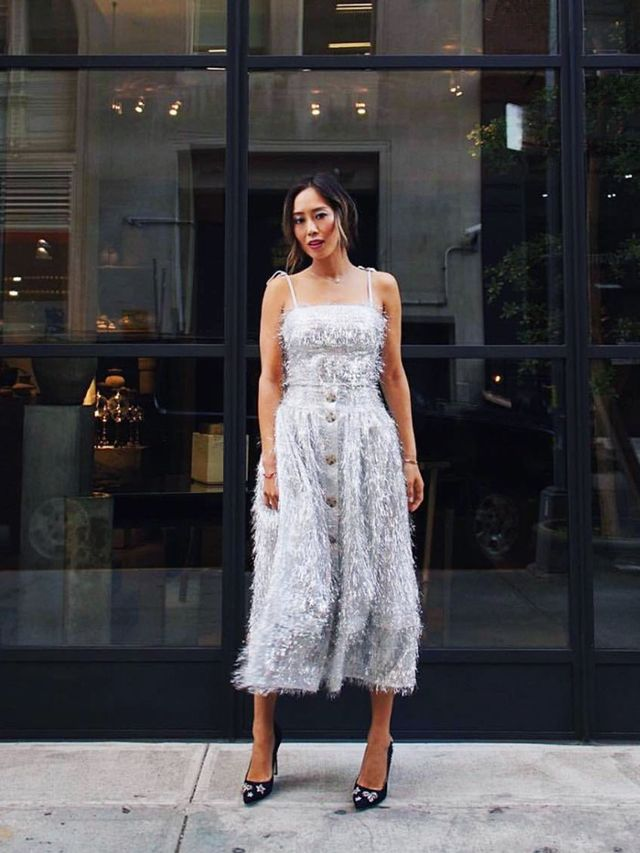 Style Notes: If you can't dress in sparkling tinsel over the festive period, when can you? Rejina Pyo's silver fringed dress with delicate ribbon straps has been the star party dress of the...