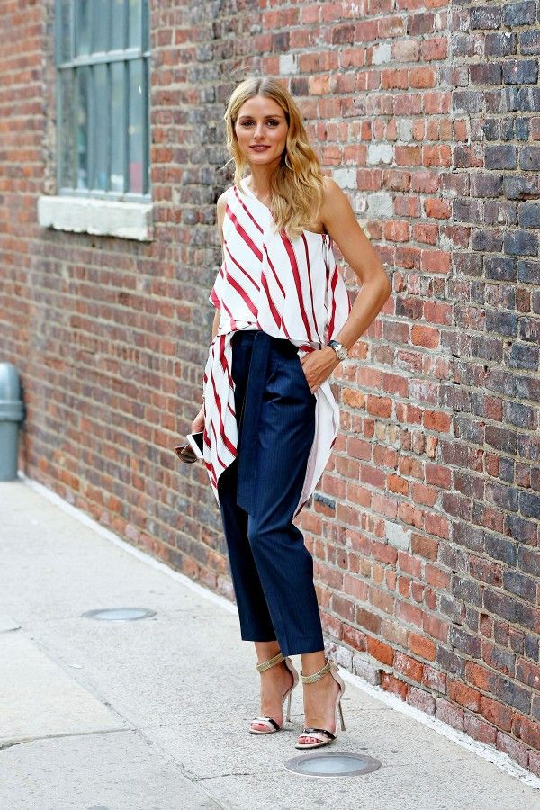 Olivia Palermo wearing a red and white top and navy pants