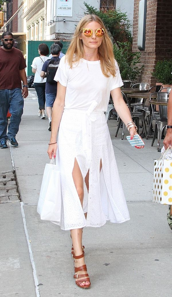 Olivia Palermo wearing a white T-shirt and car-wash skirt.