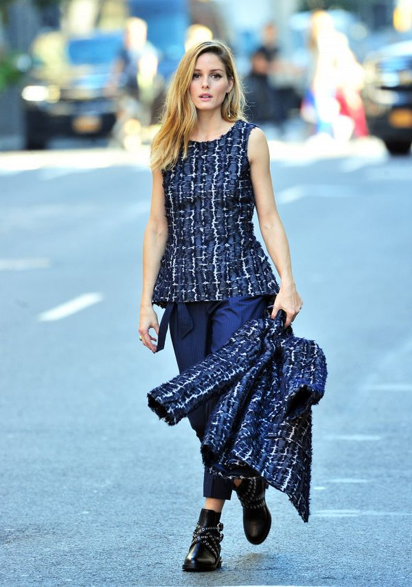 Olivia Palermo wearing a navy top, pants, and jacket