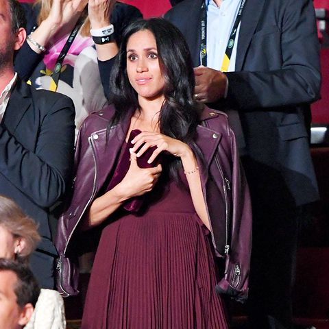 meghan markle: A stylish leather jacket over the shoulders look chic