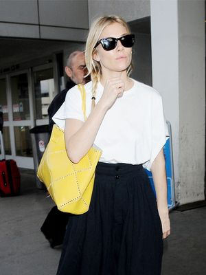 Sienna Miller Wore Your Favorite Sneakers to the Airport