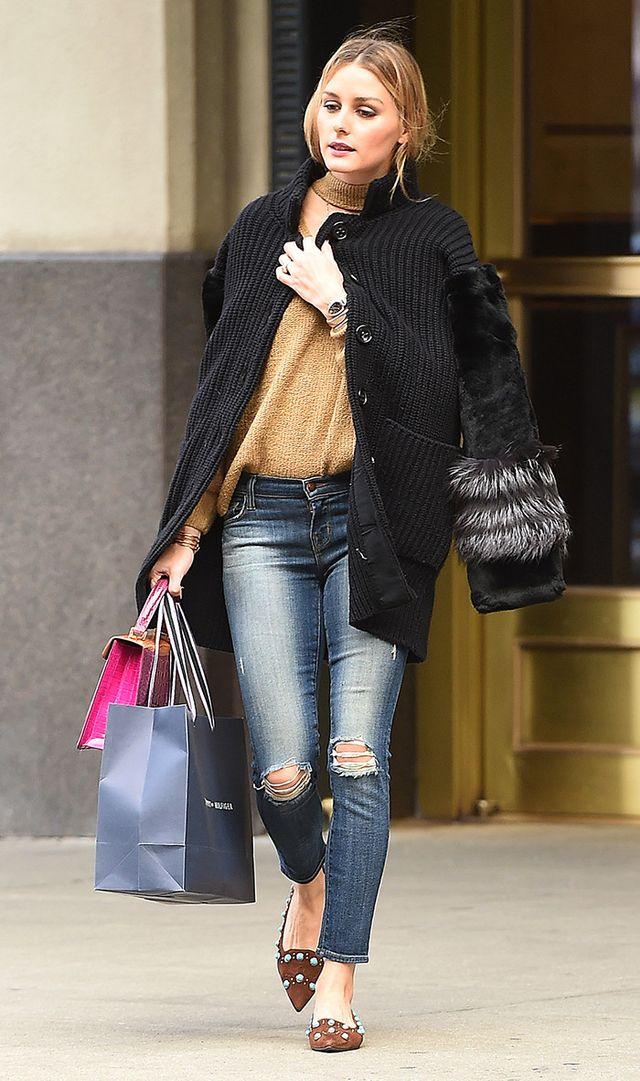 On Olivia Palermo: Storets Roa Long Sleeve Zipper Elbow Choker Pullover ($72); Analeena Dynasty Bag.