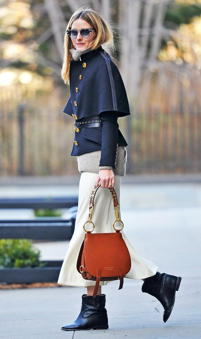 On Olivia Palermo: Burberry Wool Silk Military Cape Coat ($1295) and The Bridle Bag; Isabel Marant Cluster Boots ($835).