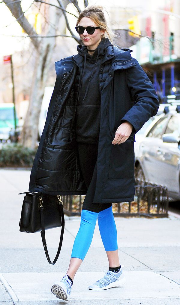 Karlie Kloss wearing leggings and sneakers street style