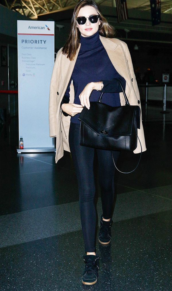 Miranda Kerr wearing leggings and camel coat