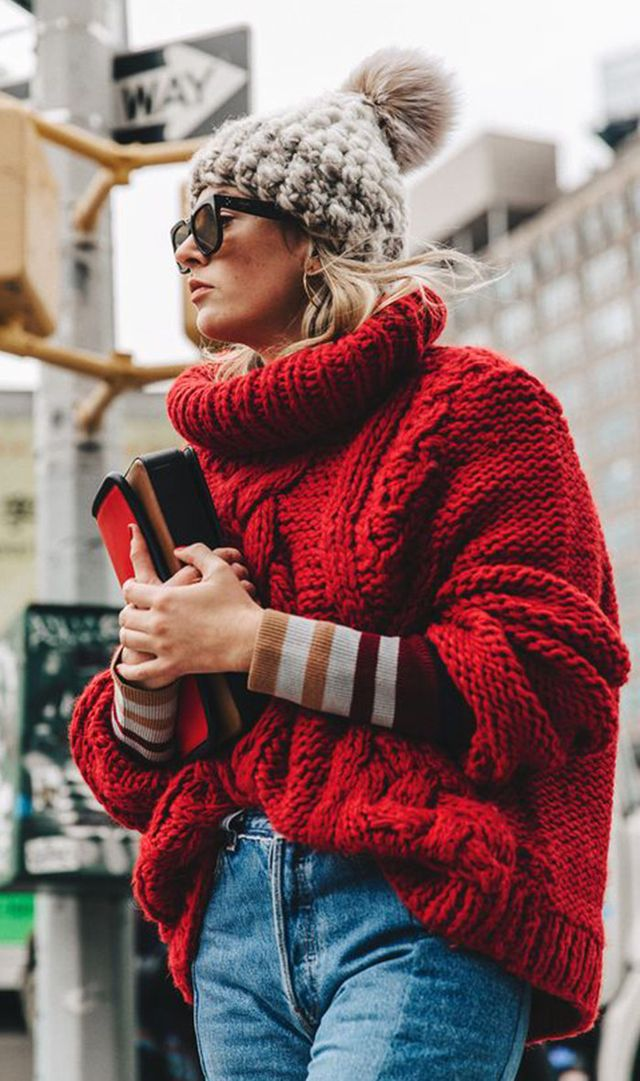 Layer your knits, and finish your look off with an oversize knit hat.