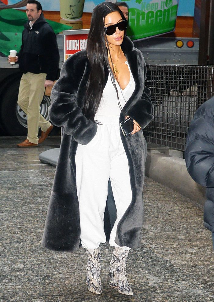 Kim Kardashian snakeskin boots and jogging bottoms