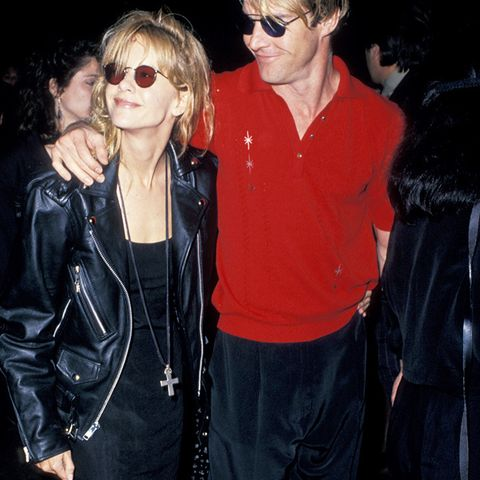 eighties fashion:  Meg Ryan wearing a leather jacket, slip dress, and big socks