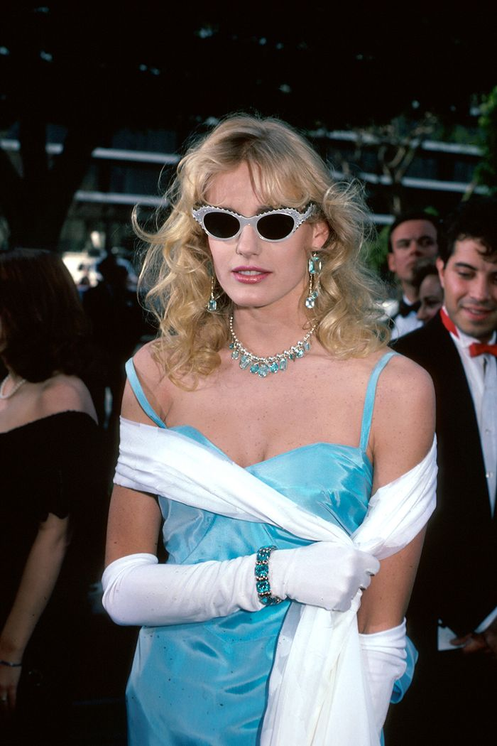 Eighties fashion: Daryl Hannah wearing a satin dress and long white gloves