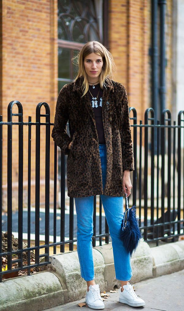 Faux fur and denim always make for a cool combo, and sneakers only improve the look.