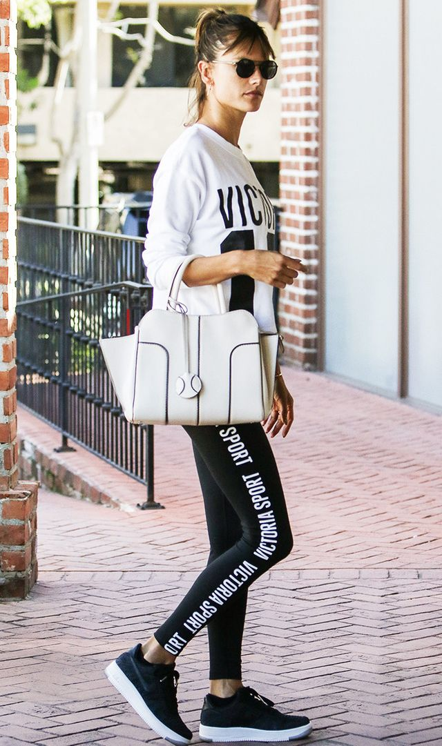 alessandra ambrosio wearing leggings and black sneakers