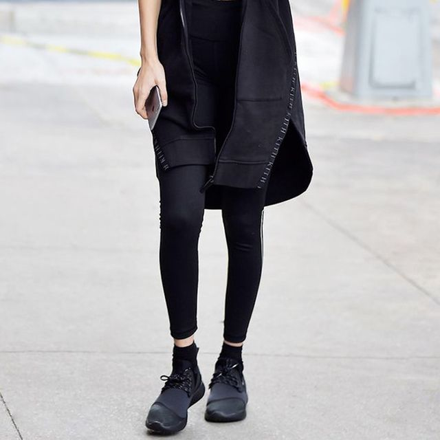Leggings and black sneakers