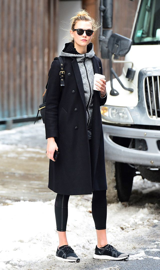 karlie kloss wearing leggings and black sneakers