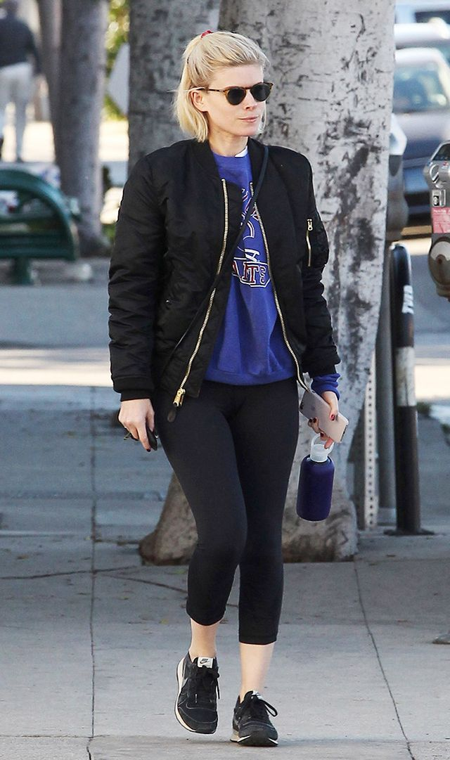 kate mara wearing leggings and black sneakers