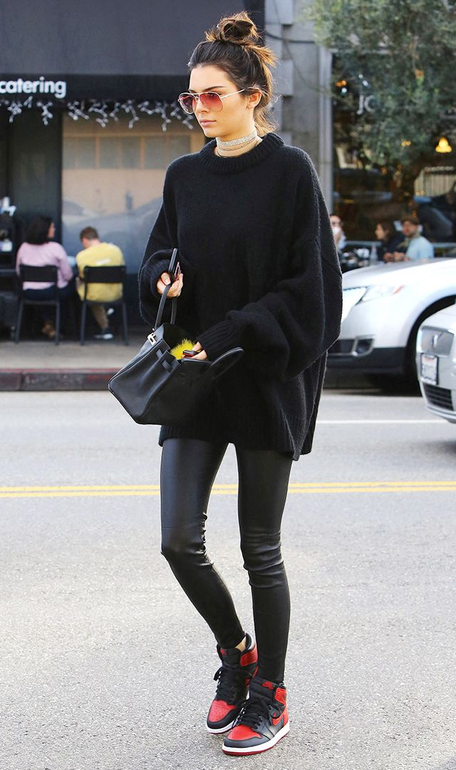Kendall jenner wearing leggings and black sneakers