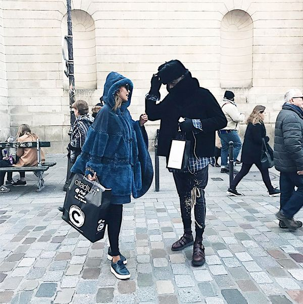 She takes on Parisian winter weather in an oversize blue fur cape and platform sneakers.
