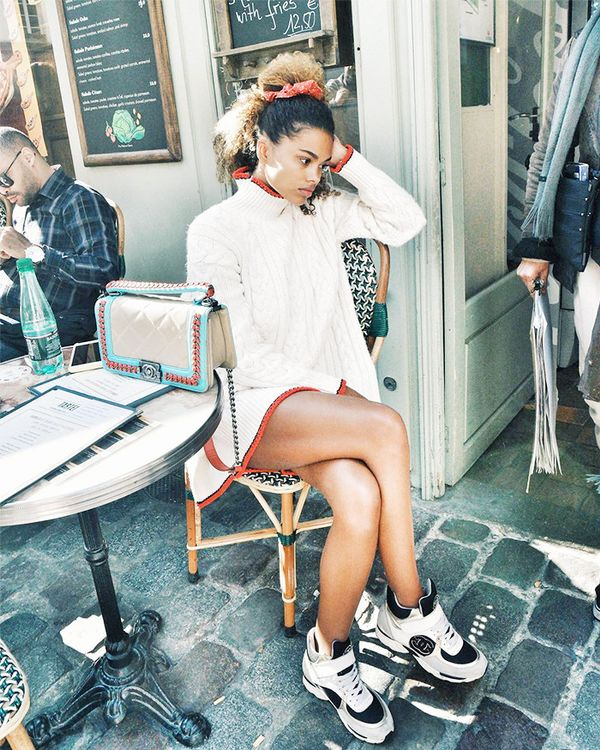 Dressing for brunch? Kunakey's answer is a sweaterdress and Chanel sneakers.