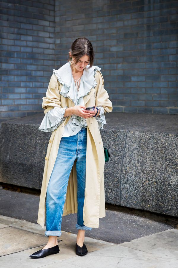Add some elegance to a trench and cuffed jeans bypairing them with a ruffled shirt and chic flats.