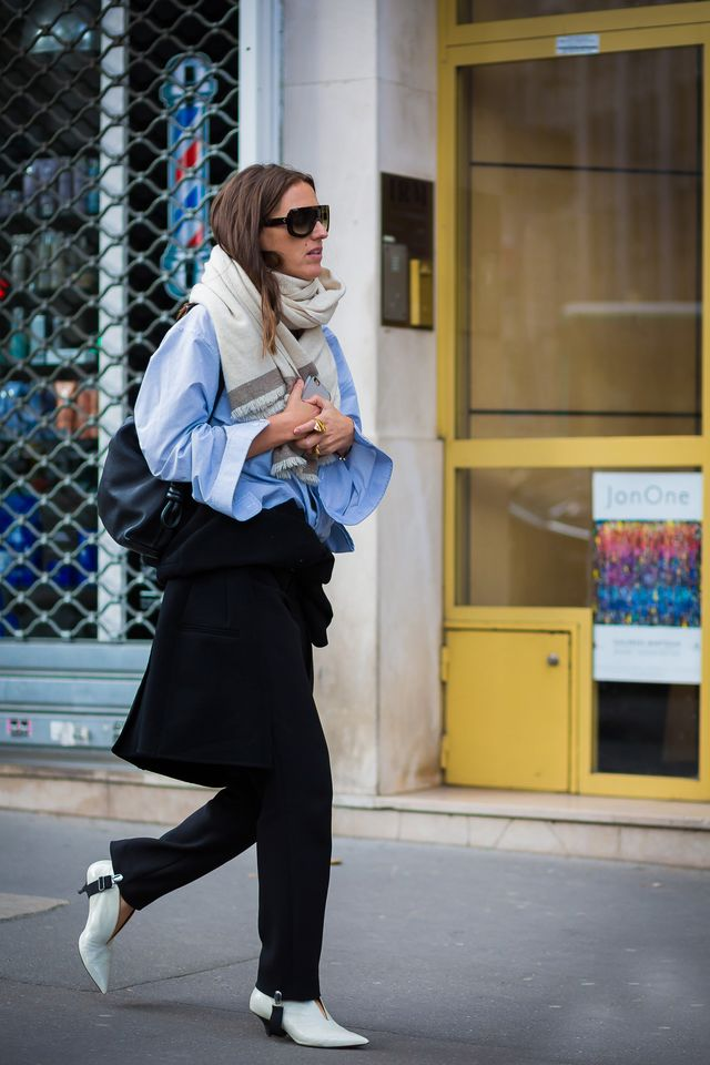 Street style blue shirt, black pants and white boots