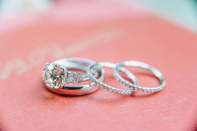 """The center stone of my engagement ring is an old-mine cut diamond from the early 1900s and is set in platinum. Using this as a jumping-off point, we worked with Ernie Eichberg to design our..."
