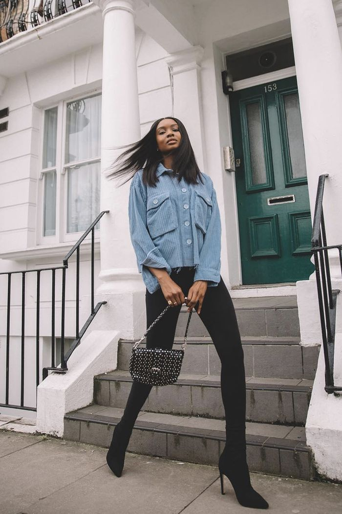 what not to wear with leggings: Natasha Ndlovu wears black leggings with a Topshop denim shacket and a Valentino studded bag