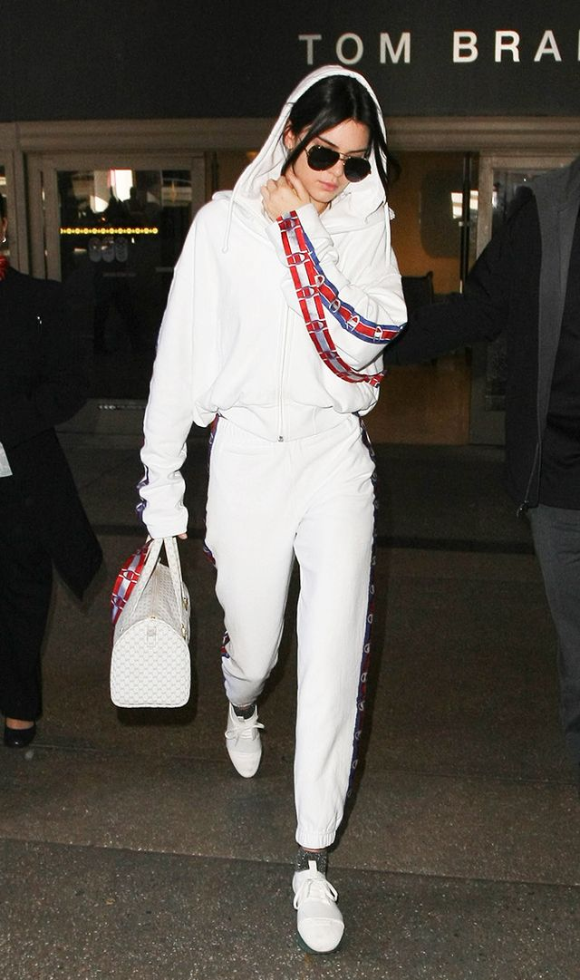 Kendall Jenner in Champion hoodie at the airport