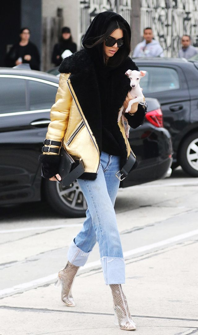 Hoods up or not, layering a basic hoodie under a statement-making jacket like this is sure to turn heads. Especially when paired with that clear Lucite boot–and-fishnets combo.