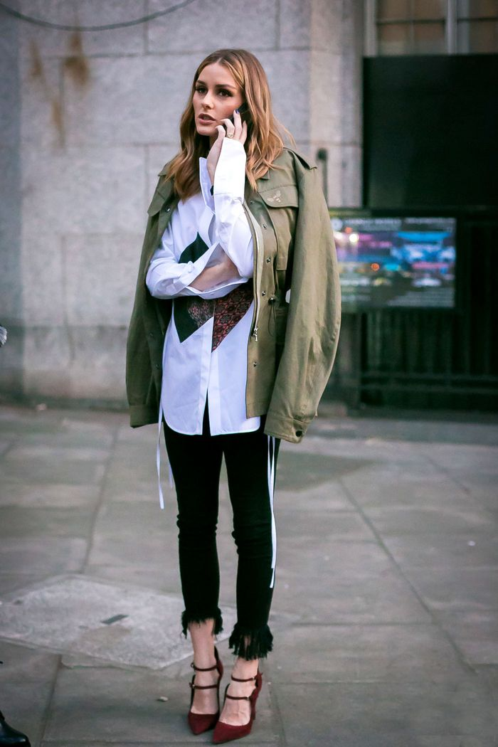 Olivia Palermo wearing an army jacket, white shirt, and black jeans