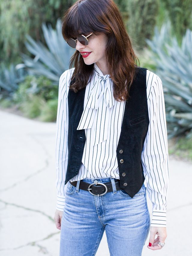 As Ash mentioned, French girlsaren't typically ones to focus on trends, especially where denim is concerned.Here, the stylist paired a chicstriped pussy-bow blouse (a French-girl staple)...