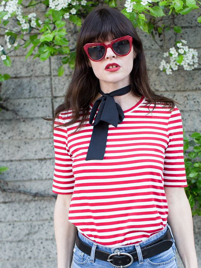 Cap off the look by tying a skinny scarf around your neck, and don't forget the classic black belt and oversize vintage-inspired sunglasses. Et voilà: You've unlocked the...