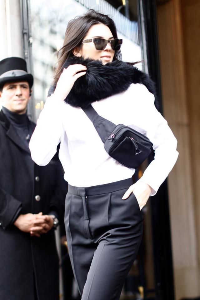 Kendall Jenner in Paris carrying a Prada bumbag.