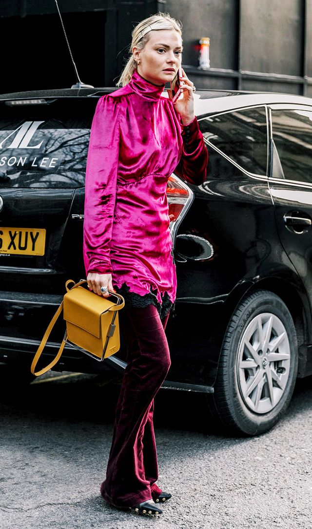 Woman wearing pink turtleneck dress over pants