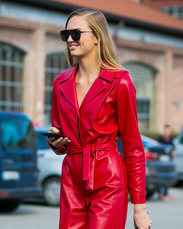 Romee Strijd wearing a red leather utility suit