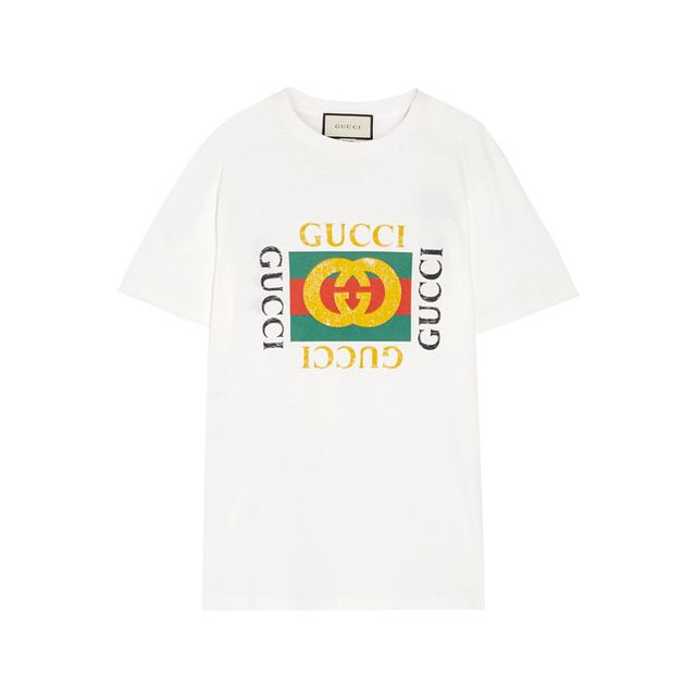 GucciAppliquéd Distressed Printed Cotton-Jersey T-Shirt Thenumber one blogger-approved item of 2017, version 2.0.