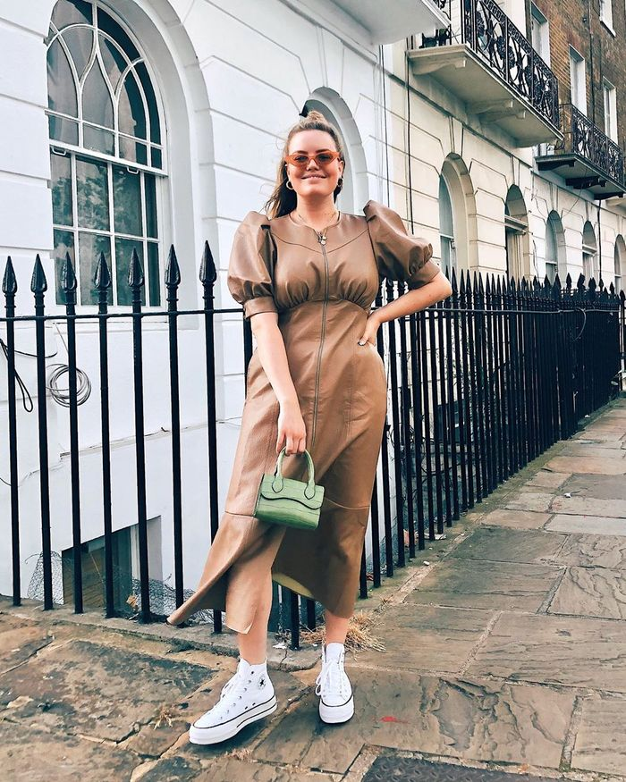Best Asos Dresses: Lotte styles her faux leather dress with trainers and a mini bag