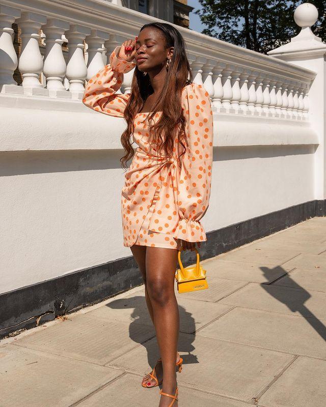 Best Asos Dresses: Eni wears an orange mini dress from ASOS