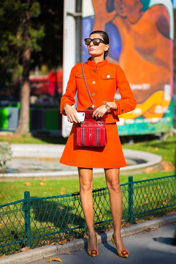 For a daytime autumn wedding, a bright two-piece skirt suit is the perfect option. Just be sure to keep accessories sharp so your look remains elevated.