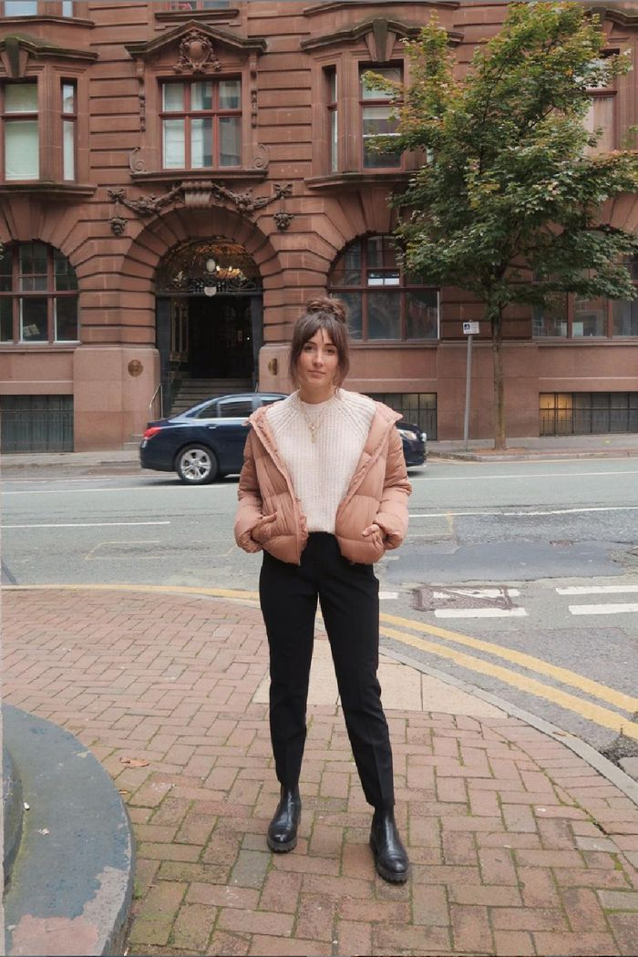 manchester style: rosie ann butcher wearing a puffer coat, cream jumper, black jeans, black boots