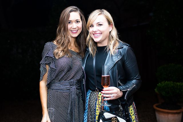 Styles, the evening's host, wore a ruffle-sleeved striped dress—the perfect contrast to all the bright ensembles. Here, her and Kerr are toasting their efforts with a glass of Veuve...