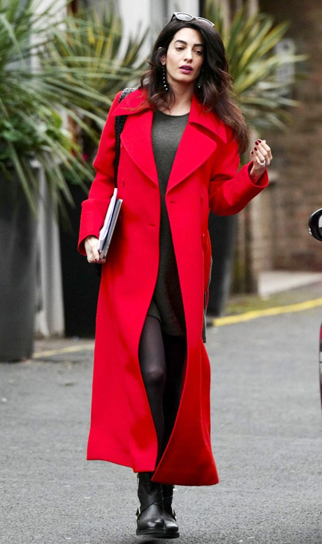 Amal Clooney wearing a red coat