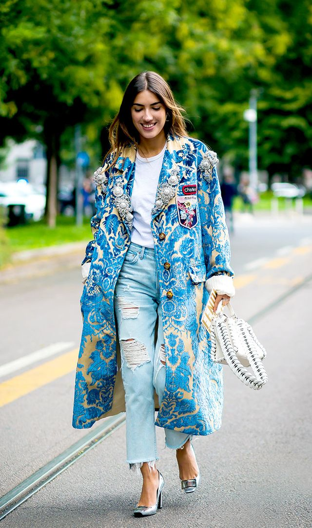 When it comes to bold outerwear, go for maximalism. Try a coat that's heavily embellished or one in a tapestry fabric.