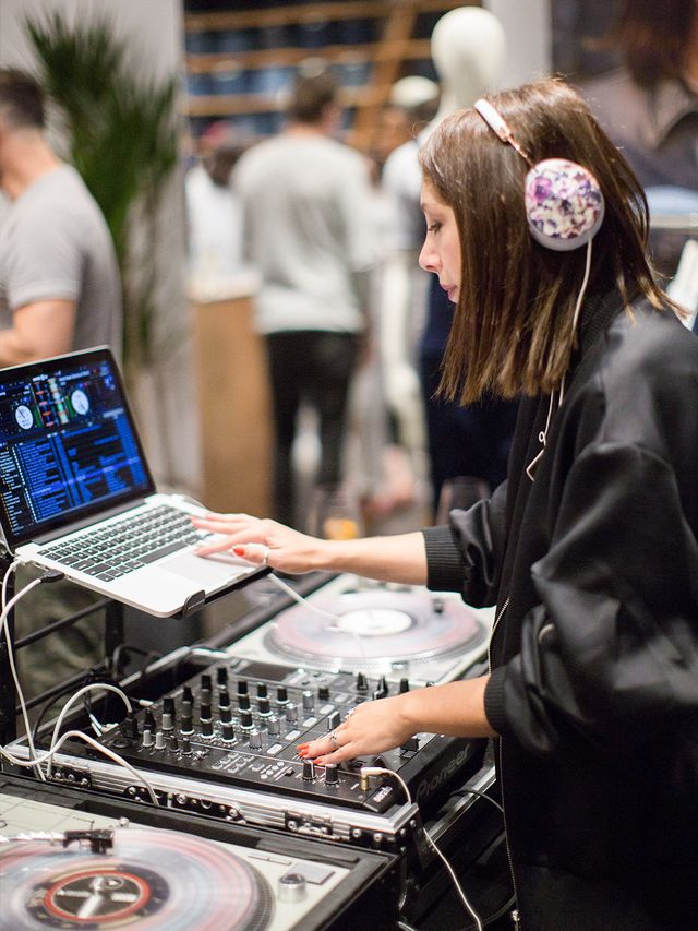 DJ Lisa Love set the mood for the evening, filling the store with tunes while guests shopped for new denim.