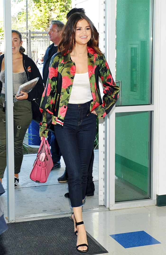 Selena Gomez floral bomber and jeans