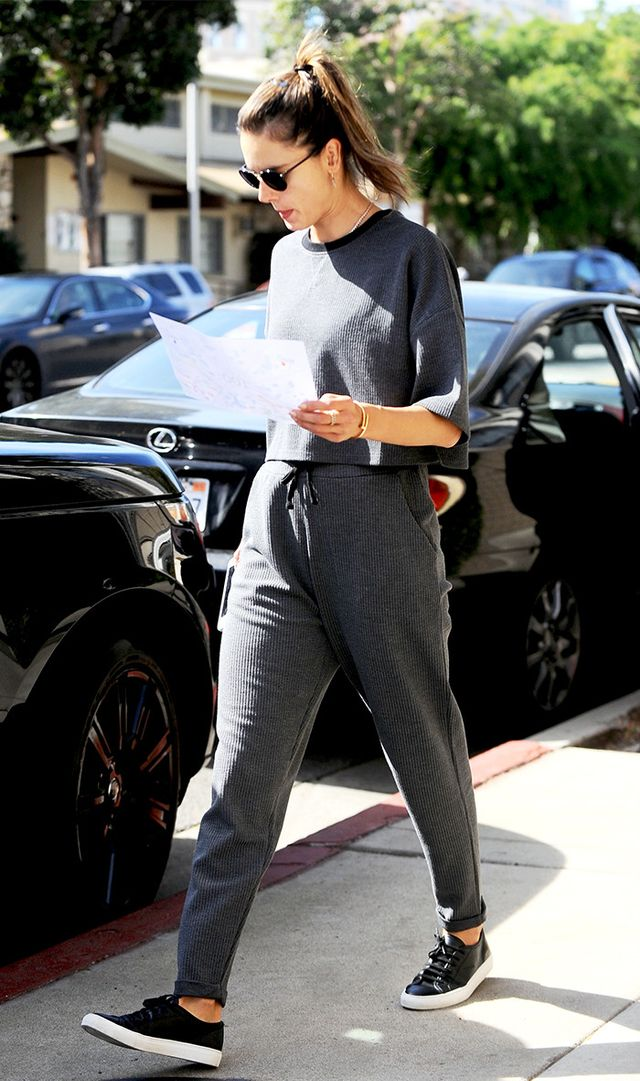 On Alessandra Ambrosio: Native Youth Catalyst Sweatshirt (£30) and Jogger Bottoms (£35); Common Projects Court Leather Sneakers (£265).