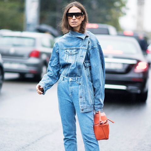 double denim: asymmetric jacket with frayed hem straight jeans and Balenciaga boots
