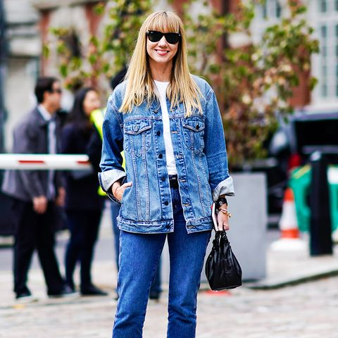 double denim: Lisa Aiken wearing darker jeans and a lighter jacket with a white tee and red shoes